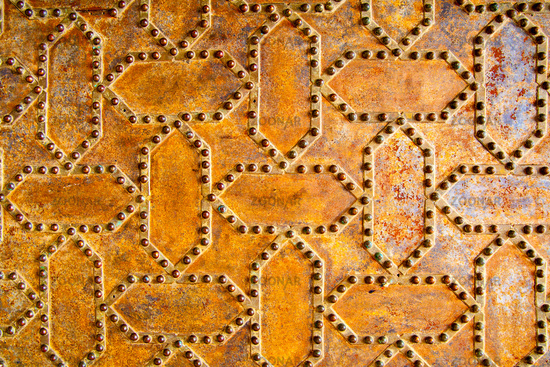Rusty surface with rivets