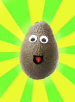 Smiling avocado with googly eyes on bright pattern backgrond