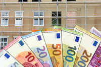Renovation costs - Euro notes with not-renovated building in background