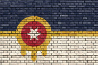 flag of Tulsa, Oklahoma painted on brick wall