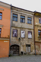 shabby old buildings in the historic city center of lublin with old photographs from the city's history