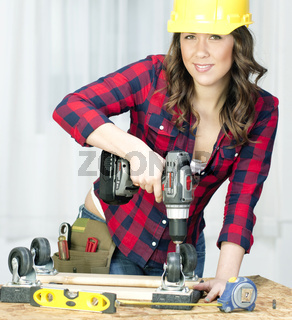 Woman Works on a Bench Repairing A Dolly