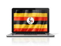 Uganda flag on laptop screen isolated on white. 3D illustration