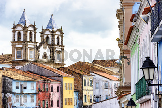 Colorful historic district of Pelourinho with cathedral tower on the background