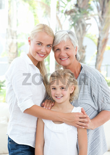Portrait of a joyful family looking at the camera
