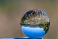 Glass ball shows view at landscape from the mountain Dolmar in Thuringia