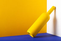 Yellow bottle on the blue table.