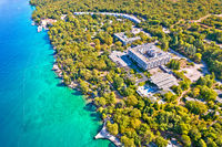 Malinska turquoise beach and old hotel ruins aerial view,