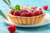 Tartlet with custard, fresh raspberries and mint.
