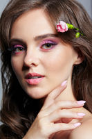 Beauty portrait of young woman Pink carnation flower in hairs