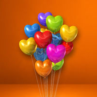 Colorful heart shape balloons bunch on orange wall background