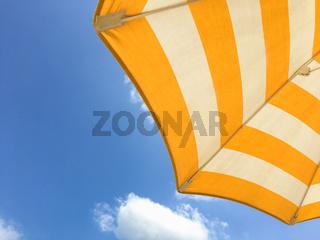 Yellow umbrella on the beach