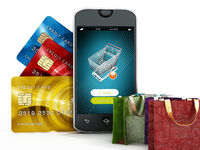 Smartphone, credit cards, shopping bags and basket