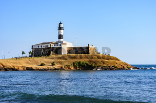 Side view of Barra Lighthouse (Farol da Barra) one of the main historical buildings and tourist spot in the city of Salvador