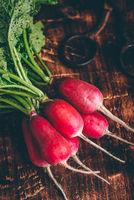 Red radish on cutting board