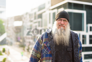 Mature bearded hipster man in the city streets outdoors