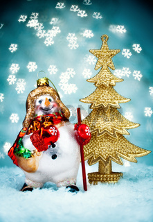 Snowman with Blue Holiday Background