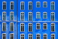 apartment building with blue facade,house exterior