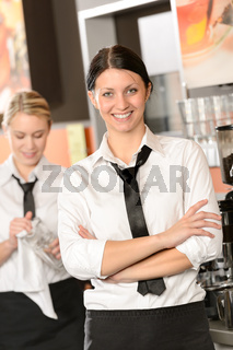 Confident waitress posing in cafe