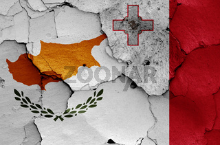 flags of Cyprus and Malta painted on cracked wall
