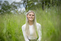 happy young blond girl on a meadow