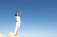 Woman success top of mountain