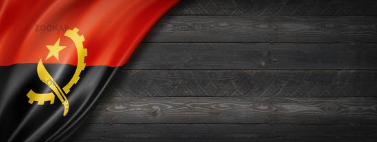 Angolan flag on black wood wall banner