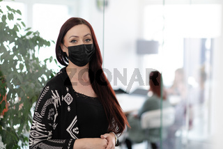 business woman portrait in medical protective mask