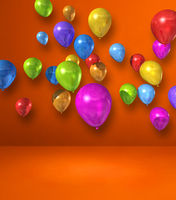 Colorful balloons group on orange wall background
