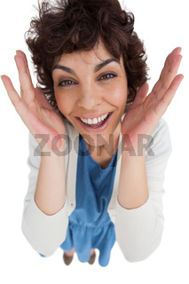 Overhead of amazed woman with hands wide opened