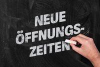 new opening hours in German on blackboard