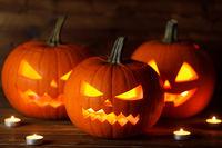 Three Halloween Pumpkins and candles