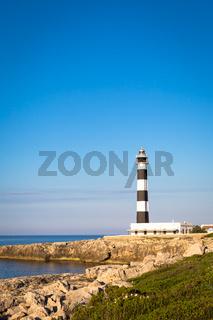 Scenic Artrutx Lighthouse at sunset in Minorca, Spain
