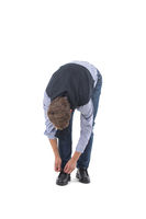 Man ties shoelaces on white