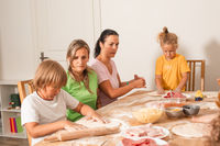 the educators together with preschoolers make pizza