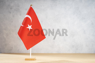 Turkey table flag on white textured wall. Copy space for text, designs or drawings