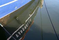 reflection of a boat in water