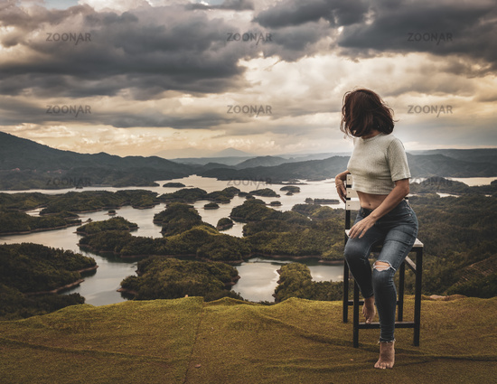 Woman overlooking Ta Dung lake. Panorama landscape
