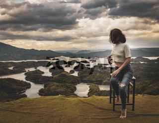 Woman overlooking Ta Dung lake. Panorama landscape