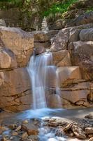 Waterfall in Bletterbach gorge near Bozen, South Tyrol