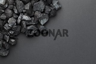Black Coal Pile Over Dark Background