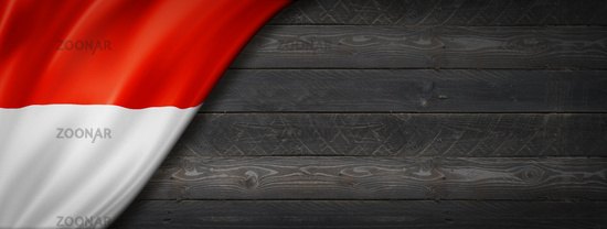 Monaco flag on black wood wall banner