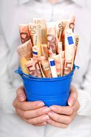 Euro money in woman's hands. Financial concept.