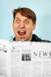 Man shocked - bad news from newspaper