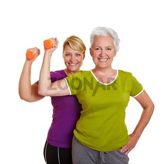 Zwei Frauen machen Hanteltraining