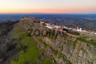 Marvao drone aerial view of the historic village and Serra de Sao Mamede mountain at sunset, in Portugal