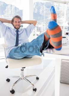 Shoeless designer kicking back