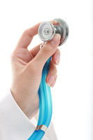 Doctor. Blue stethoscope in hand over white background.