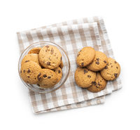 Sweet chocolate biscuits on checkered napkin.