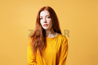 pretty young lady with neutral expression